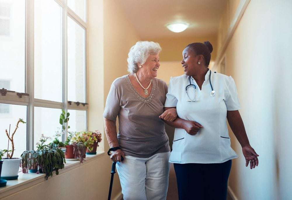 Company Image (Hales Care: Carer and Resident chatting)