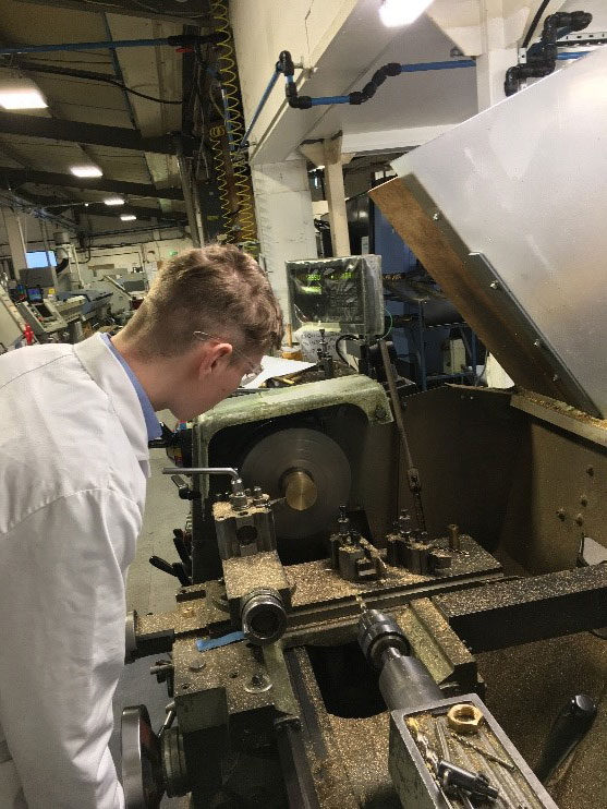 Company Image (GASARC: Apprentice using some machinery)