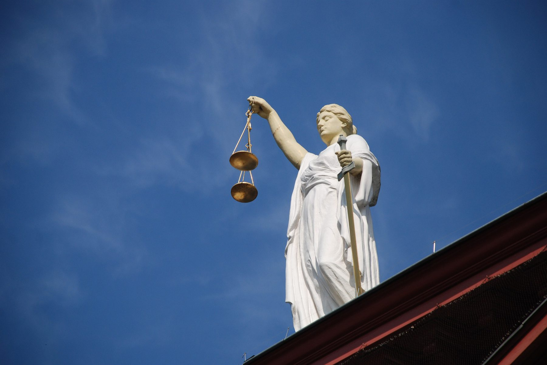 Legal Services (Sector Header: Statue Holding Scales)