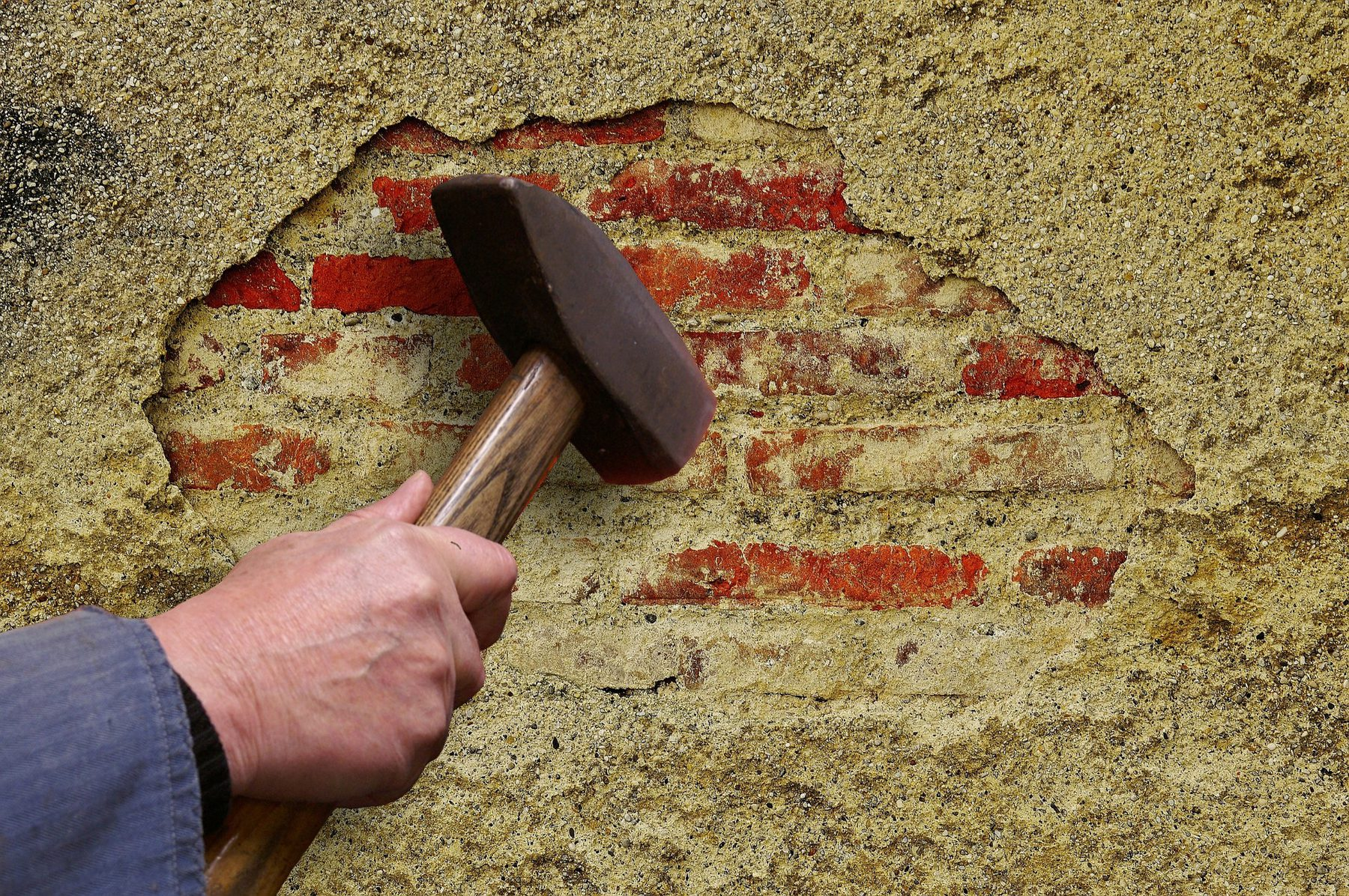 Job Role Image (Plasterer: Hammer Chipping at Plaster)