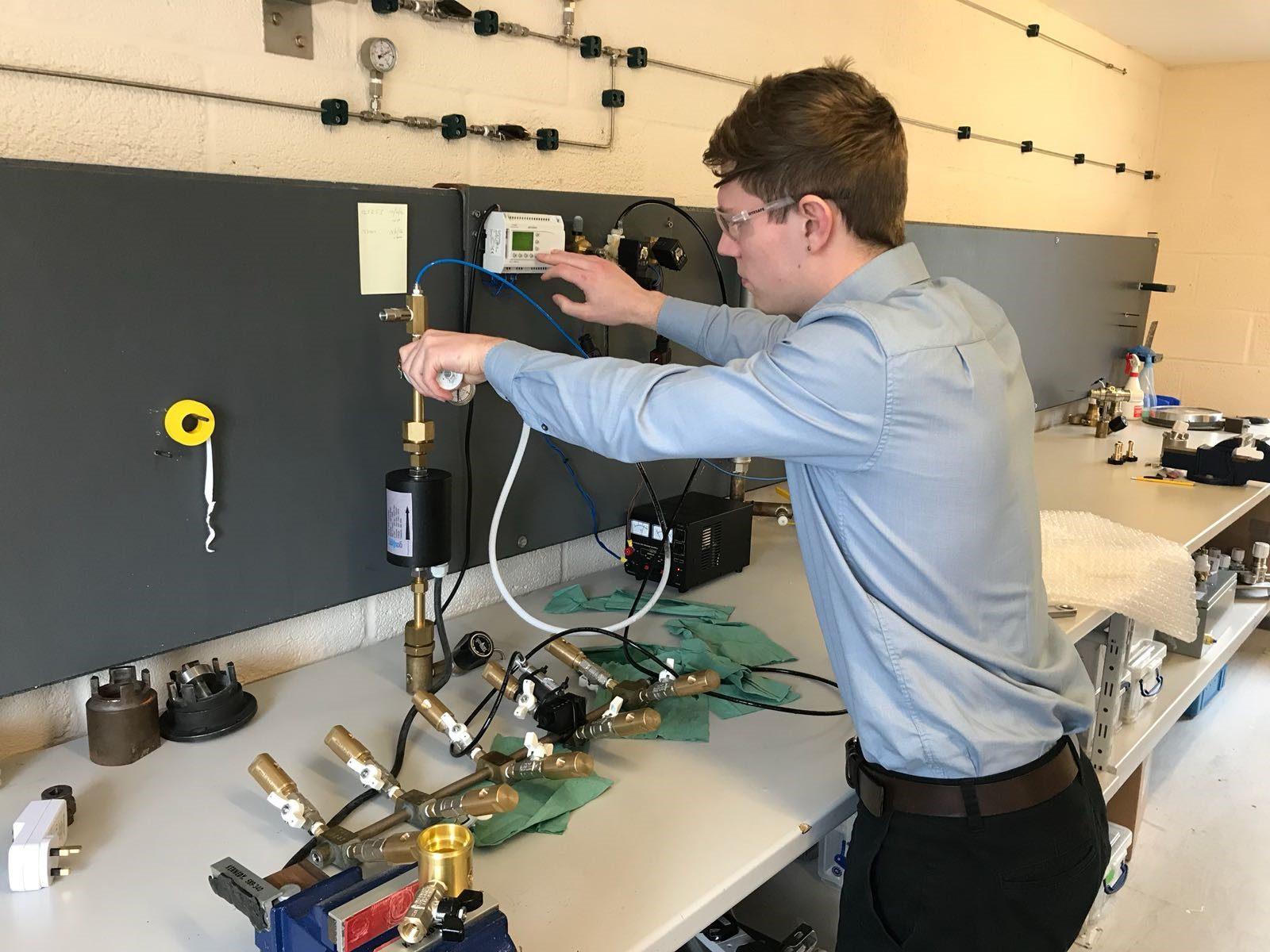 Company Image (GASARC: Apprentice using some equipment in lab)