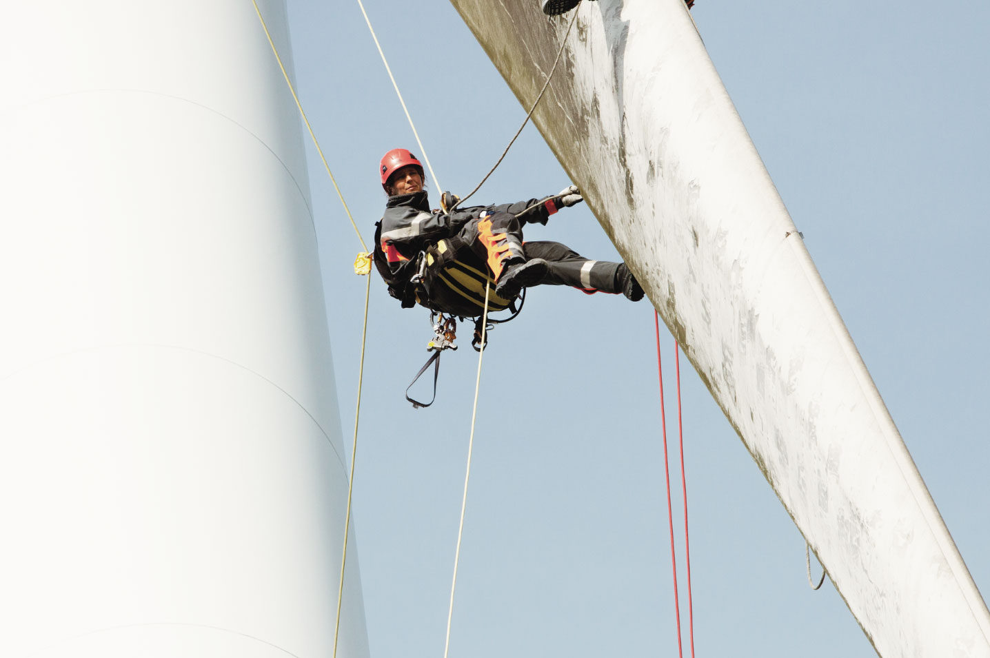 Company Image (Vattenfall: Woman on top of Wind Turbine - blade)