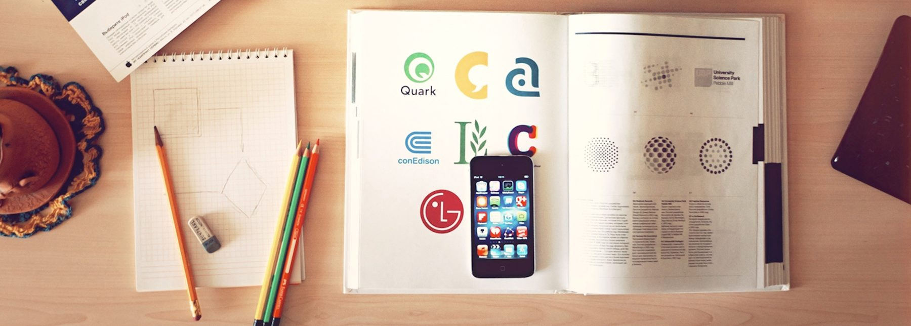 (Company Image (Hybrid Access: Mobile, Book, Paper, Designs, Table)